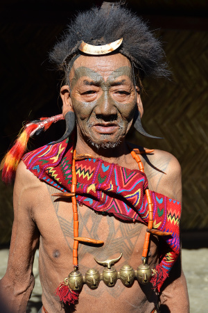 Warrior from the Konyak tribe in India with traditional tattoos
